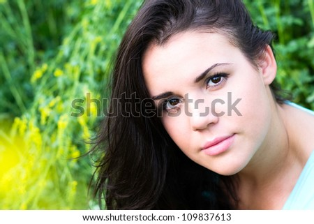 Closeup portrait of a beautiful girl on nature