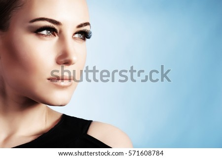 Shutterstock Closeup portrait of a beautiful woman isolated on blue background, gorgeous girl with perfect makeup, good looking model