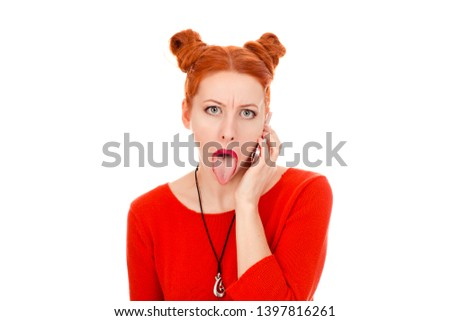 Closeup portrait of a beautiful woman with phone tongue out talking on phone in her 30s wearing red blouse standing posing on pure white background wall. Mixed race, Irish Hispanic, Caucasian model
