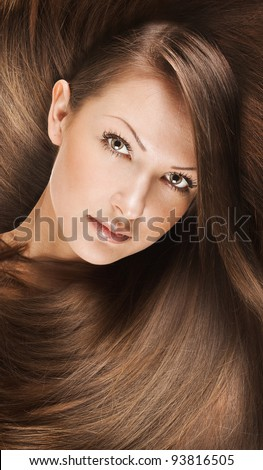closeup portrait of a beautiful young woman with elegant long shiny hair , concept fashion hairstyle
