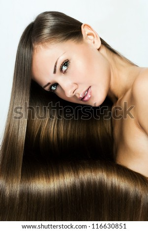 closeup portrait of a beautiful young woman with elegant long shiny hair , hairstyle