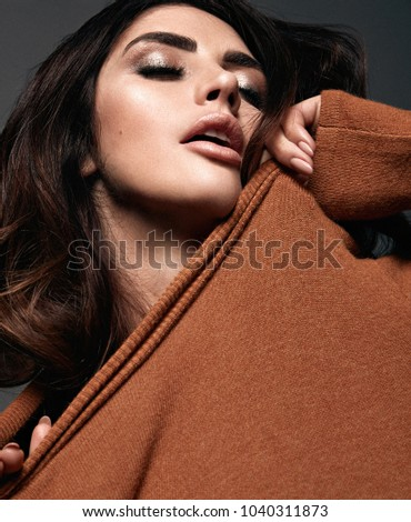 Closeup portrait of a beautoful woman wearing trendy clothes #1040311873