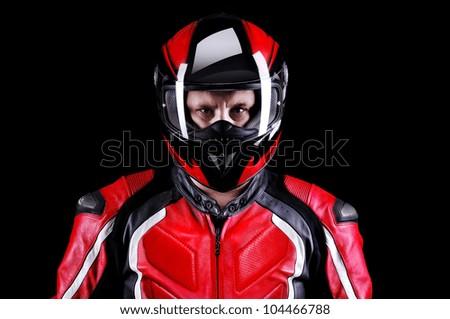 Closeup portrait of a biker in helmet on black background