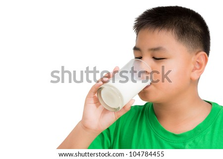 Closeup portrait of a boy drinking a glass of milk, Isolated on white