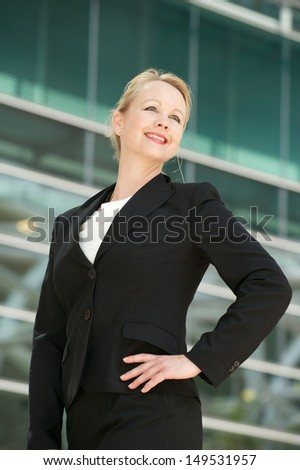 Closeup portrait of a business woman smiling outdoors