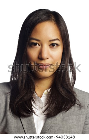Closeup portrait of a confident asian business woman with folded arms over white background