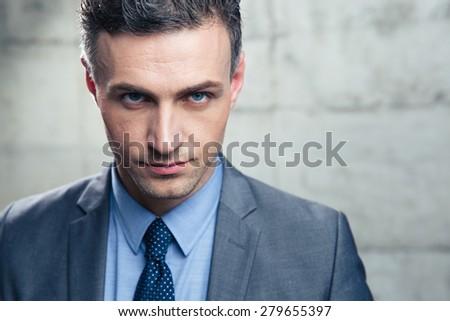 Closeup portrait of a confident businessman looking at camera