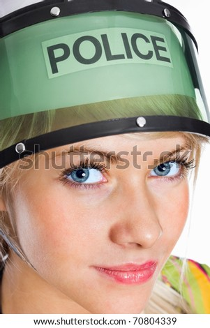 Closeup portrait of a confident young police woman looking at you