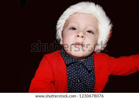 334b649d16f Closeup portrait of a cute little baby boy wearing red Santa Claus hat  isolated on white
