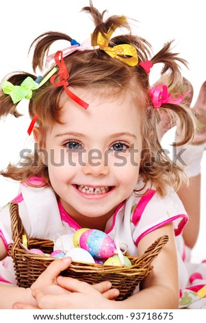 Closeup portrait of a cute little girl with Easter eggs in basket