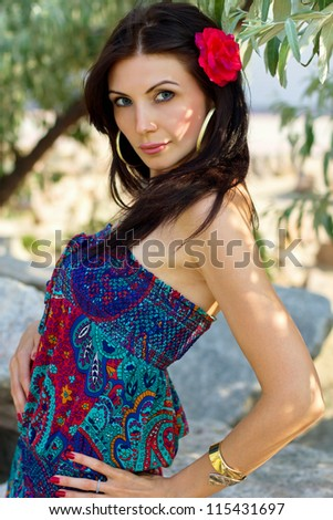 Closeup portrait of a cute young brunette outdoors
