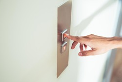 Closeup portrait of a female finger pushing elevator button
