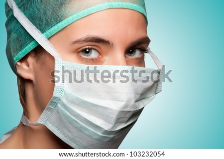 Closeup portrait of a female surgeon in a green background