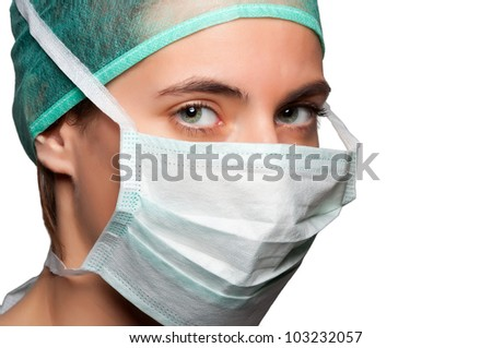 Closeup portrait of a female surgeon isolated in a white background