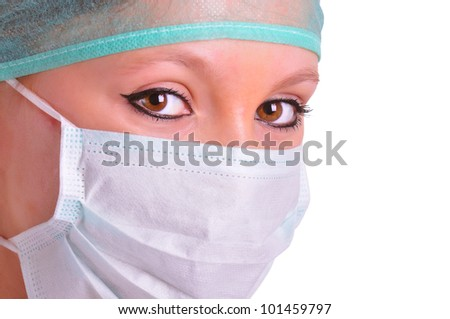 Closeup portrait of a female surgeon isolated in white
