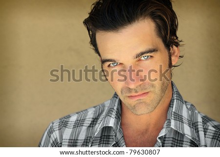 Closeup portrait of a good looking young man - stock photo
