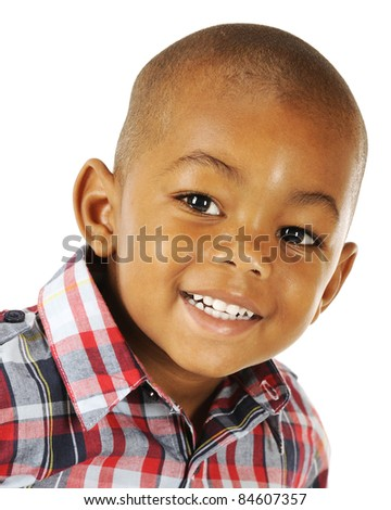 Closeup portrait of a happy African American preschooler on a white background.