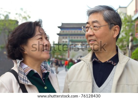Closeup portrait of a happy aged Chinese couple looking at each other