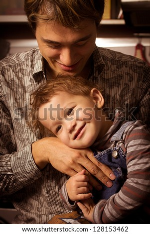 Closeup portrait of a happy father and son together - Indoor