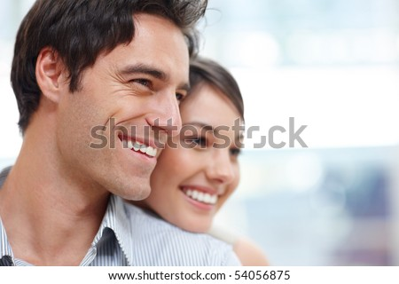 stock photo : Closeup portrait of a happy young couple looking at something interesting - Copyspace