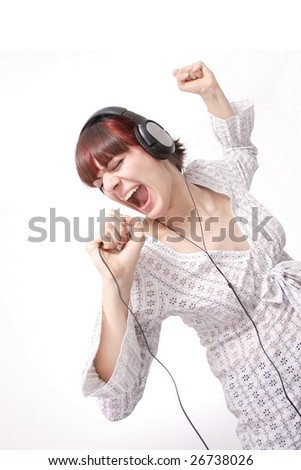 Closeup portrait of a happy young woman singing isolated on white background