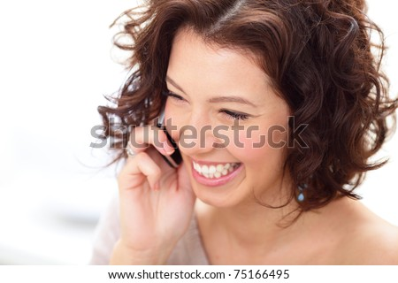 Closeup portrait of a laughing woman talking on phone