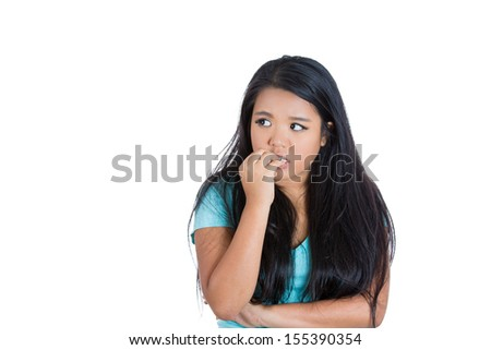 Closeup portrait of a nervous woman biting her nails craving for something or anxious, isolated on white background with copy space