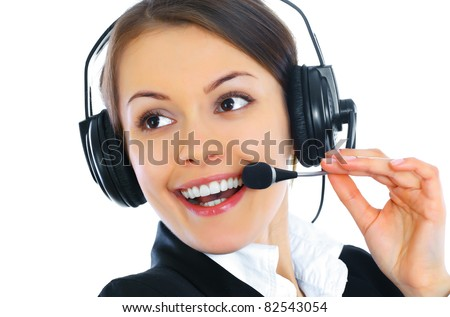 Closeup portrait of a pretty female call centre employee smiling with a headset on white background