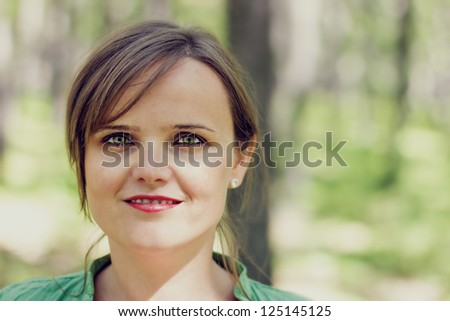 Closeup portrait of a pretty young lady outdoors