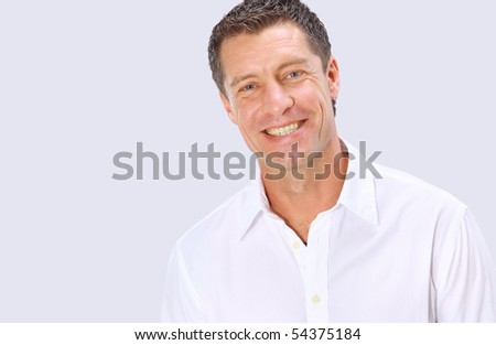 Closeup portrait of a  senior man smiling on white background #54375184