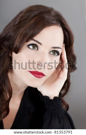 Closeup portrait of a sensuous middle aged woman looking away - stock photo