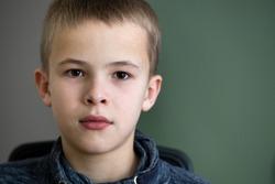 Closeup portrait of a serious child school boy.