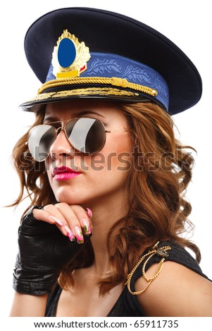 Closeup portrait of a sexy policewoman in leather gloves and blue hat isolated on white background
