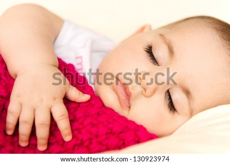 Closeup portrait of a sleeping baby girl