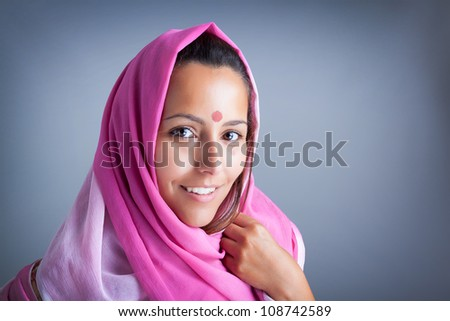 Closeup portrait of a smiling beautiful young indian woman