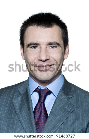 Closeup portrait of a smiling handsome man in studio on isolated white background
