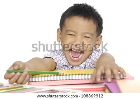 Closeup portrait of a smiling little boy doing homework
