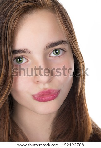 closeup portrait of a teenage girl kissing lips isolated on white #152192708