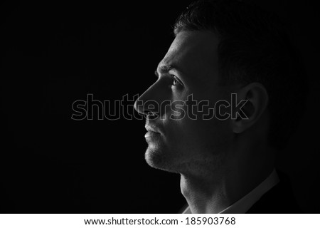 Closeup portrait of a thoughtful man. Black and white photo.