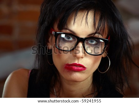 closeup portrait of a woman with flowing make-up and in glasses