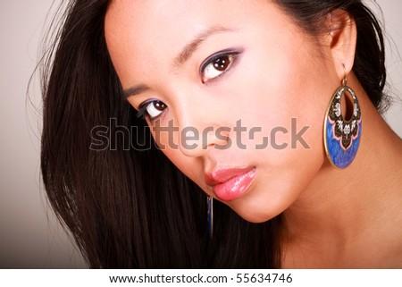 asian model makeup. stock photo : Closeup portrait of a young beautiful asian model with makeup