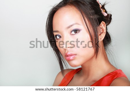 Closeup portrait of a young beautiful asian woman