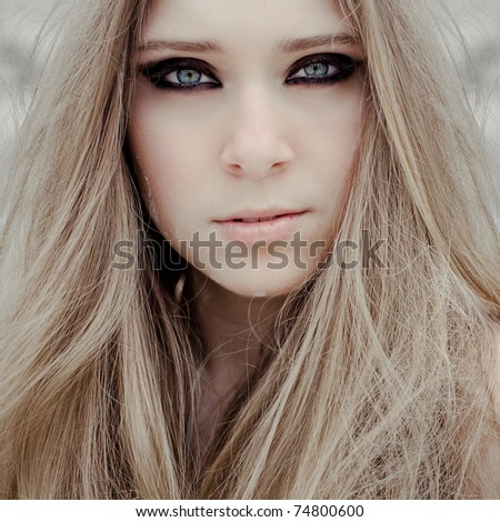 Closeup portrait of a  young beautiful girl with smoky eye makeup