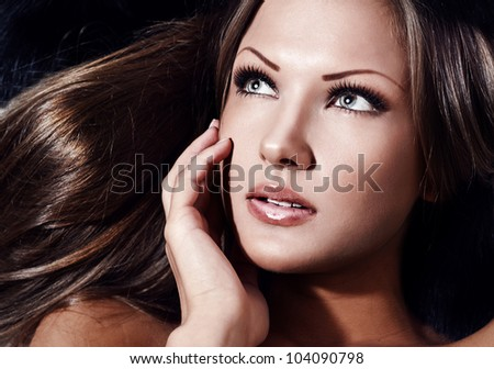 closeup portrait of a young beautiful sensual woman with perfect clean skin face , make up
