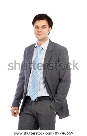 Closeup portrait of a young businessman in suit, isolated on white background