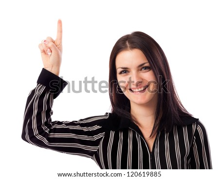 Closeup portrait of a young businesswoman pointing up at copyspace isolated on white background