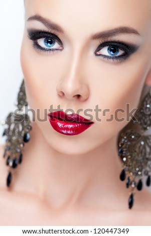 Closeup portrait of a young lady with glamorous makeup