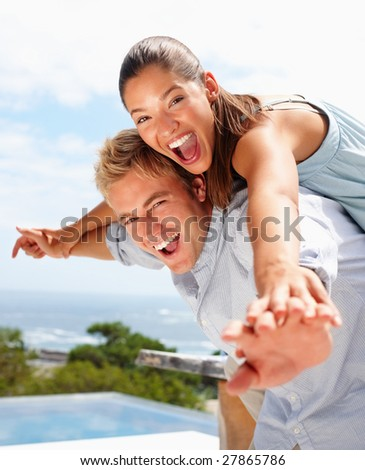 stock photo : Closeup portrait of a young man and his girlfriend stretching their hands together