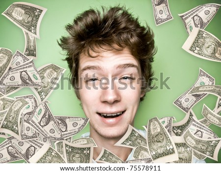 Closeup portrait of a young man with money rain - stock photo