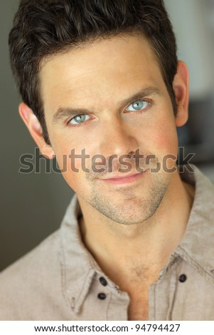 Closeup portrait of a young pleasant attractive man